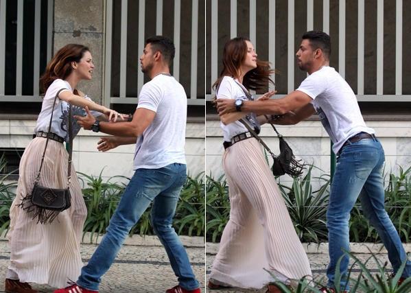 Dupla de atores, que são namorados na trama, gravam cenas de briga.